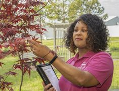 """As Earth Day approaches April 22, Marshall sustainability coordinator Malene McElroy says team members don't need green thumbs to promote environmental awareness – just """"green hearts."""" Team Member, Nasa, Sustainability, Promotion, Action, April 22, Green, Gadgets, Hearts"""
