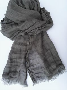 This grey scarf, soft and lightweight linen fabric. It is perfect for all seasons – cool in summer and comfortable in autumn/winter.  Size: about 47 cm x 205 cm / 19 x 81 + fringes Material: 100% linen, softened, lightweight  Care: gentle wash at 40°C. You can iron, lay flat or twist and let dry to get a texture. After each washing linen fabric becomes softer and less wrinkly.  Handmade with love in Lithuania (Europe)  Shipping: Generally shipping takes about 5 to 10 business days i...