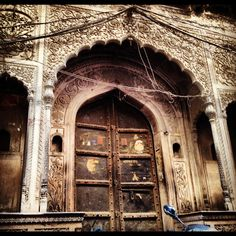 Hidden in one of the alleys of old Delhi is this mesmerizing palace of yesteryear. Wires framing the door way, stray dogs acting as guards, it is today used as a dharamshala (resthouse). By looking at it you can tell that once upon a time this must've been a magnificent haveli, today a forgotten beauty.