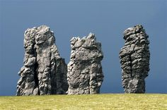 The Mysterious Manpupuner Rock Formations - The Manpupuner rock formations also known as the Seven Strong Men Rock Formations are a set of 7 gigantic abnormally shaped stone pillars located north of the Ural mountains in the Komi Republic, Russia. These monoliths are around 30 to42 meters high and jut out of a hilly plateau out of nowhere.