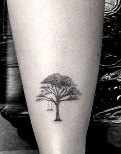 Beautiful tree/swing tattoo. This article about this artist - Dr. Woo - shows a very talented tatoo artist!