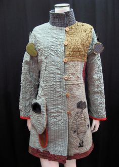 Wearable art jacket by Danny Mansmith.   I chose this piece because it is art and is creative but Also a beautiful garment with subdued colors that inspire me.  I would like to create something minimal yet elegant like this that holds a strong message.