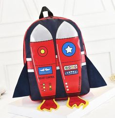 This bag is big enough to fit an iPad. Fabric: Canvas Color: Orange, Red, Pink, Blue size: Width: 28-29cm, height: 40cm, bottom thickness: 11cm; (divide by 2.54 for the size in inches)