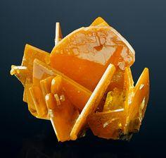 Wulfenite, Glove Mine, Arizona, USA Size: 4.6 x 3.2 x 3.3 cm. Wulfenite crystals to 29 mm on edge in a very nice crystal cluster