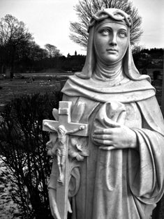 Although Not Positively Identified, This Marble Statue of a Female Saint Found at St. John's Cemetery in Worcester Is Most Likely St. Catherine of Siena Because of the Crown of Thorns She Wears