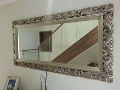 Big Wall Mirrors a large wall mirror with brown frame. it can be placed in the