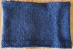 Hand-knitted blue neck warmer with reflective effect for dark evenings