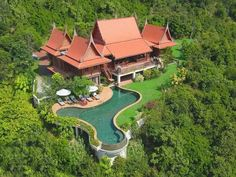 """'A luxurious experience of ancient Siam' Tassana Pra , meaning """"House facing towards the Buddha"""", is an authentic teakwood villa, and has become a symbol of Thai elegance on the island of Samui and beyond (Big Buddah, Koh Samui) Thailand Destinations, Thai House, Koh Samui, Samui Thailand, Luxury Villa Rentals, Resort Villa, Traditional House, Location, Hotels And Resorts"""