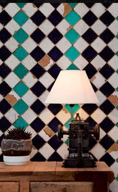 Turquoise elements add an interesting contrast to this diagonal chessboard tile pattern, whilst leading the eye to the weathered tiles which give t. Rustic Wallpaper, Style Rustique, Turquoise, Tile Patterns, Chess, Rustic Style, Pattern Wallpaper, Brick, Tiles