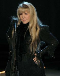 Stevie onstage  ~ ☆♥❤♥☆ ~   hands on her hips, like she owns the stage ~ and millions of her fans world-wide would agree