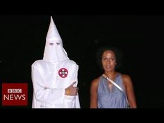 Mo Asumang , daughter of a black Ghanaian father and a white German mother, talks to BBC News about making her new documentary, The Aryans , in which she confronts racists, both in Germany and among the Ku Klux Klan in America. | Watch This Black Woman Confront Racism Face-To-Face As She Talks To Neo-Nazi's And KKK Members