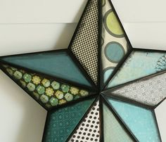 Metal star, fancy cardstock, and Modge Podge make a beautiful wall hanging for all year.