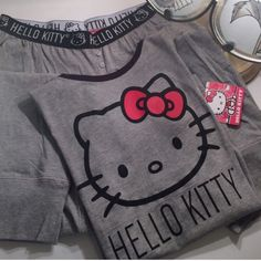 """Hello Kitty Pajamas Black and Grey short sleeve top with the Hello Kitty Logo imprinted on front. Long pants with elastic waistband with the Hello Kitty Logo imprinted all the way around. 85% Cotton, 15% Viscose. From inseam to hem 28"""". Wonderful Christmas gift!! Hello Kitty by Sanrio❤️ Intimates & Sleepwear Pajamas"""