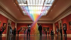 The Great Gallery of Toledo Museum of Art, Ohio, is usually filled with classic art pieces that date back decades and even hundreds of years back. But now it's been refreshed by this gorgeous man-made rainbow placed right in the middle of it.