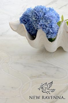 Ursula, a natural stone waterjet and hand cut mosaic shown in Calacatta Tia and Thassos, is part of the Silk Road Collection by Sara Baldwin for New Ravenna Mosaics.