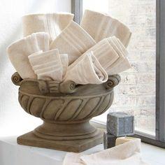 ¡Qué idea! ¡Un macetero para tener a manos las toallas!