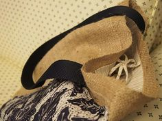 Single strap burlap with designer applique