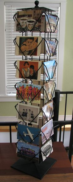 Reserved-Vintage Spinning Postcard Rack Industrial Card Display - Heavy Metal Base - Has 28 Slots For 4 x 6 Postcards. $100.00, via Etsy.