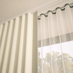 ripplefold double. This can be made with a single layer of decorative blackout fabric and another layer of sheer to reduce the traditional cost of using both a decorative fabric and a blackout lining. Design Nashville