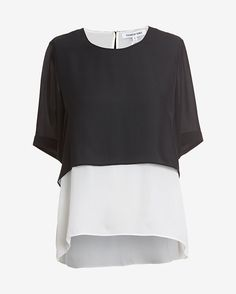 Elizabeth and James Tulsi Double Layer Blouse: A double layered contrasting chiffon makes for airy elegance on this top. Button closure at nape. 3/4 length sleeves. Semi sheer. In black/white. Fabric: 100% silk Model Measurements: Height 5'10; Waist 25 ; Bust 32   Length from shoulder to hem: 25 for ...