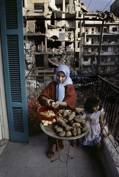 Woman and girl, buildings with walls blown off. Life goes on. Beirut, Lebanon. Steve McCurry |