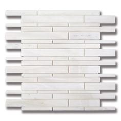 AKDO's White Haze stone mosaic in a stagger pattern adds subtle texture and pattern to backsplashes and walls in kitchen and bath designs.