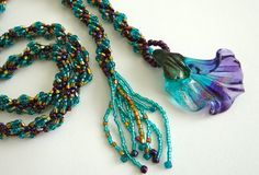 Beaded lariat spiral rope necklace lampwork flower focal bead metallic delica seed beads with dichroic glass flower pendant 44 inches long