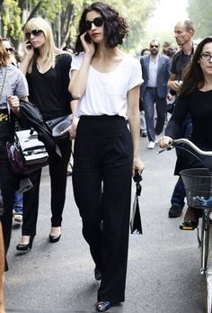Caroline Issa, in simple white  t shirt and wide legged trousers. Love the haircut