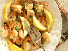 Recipe is originally from the Food Network courtesy of Rachael Ray, but I tweaked it to fit our tastes. Very quick And easy shrimp recipe thats done on the stovetop. If your tastes desire spicy And garlic, then this recipe is just for you.