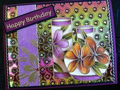 Background for this card is an embossed piece of Gemstone Fire Opal Shimmer Sheetz and the Asian Vases is a Peel Off sticker from Elizabeth Craft Designs colored with the Tim Holtz/Ranger Distress Markers. I used a piece of Transfer Sheet to transfer the negative parts from the vase onto the strip of Glitter Ritz micro fine glitter.