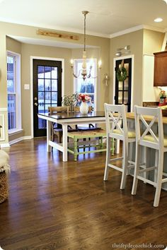 Love this kitchen {especially the mismatched chairs/bench}