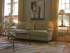11 Area Rug Rules and How to Break Them  Rule 1: Front legs on the rug, back legs off. Here is a gorgeous room where the front legs sit on the rug while others are off. This approach really does work in most situations; the rug connects the various furniture pieces together while extending far enough into the room to create a sense of good proportion.