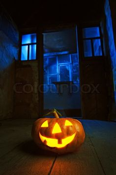 Stock photo ✓ 10 M images ✓ High quality images for web & print | Halloween pumpkin in night on old wood room with blue window