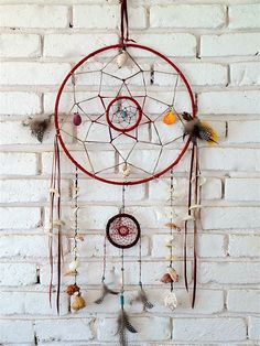 My favourite dream catcher, red leather with tassels, feathers, shells and beading (& feathers)!