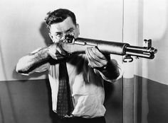 John C. Garand (1888-1974) aiming the semi-automatic .30-06 caliber M1 military rifle he invented (ca. 1935). The M1 Garand was used by U.S. infantrymen in World War II and the Korean War, and its gas-operated locking system was the basis for that used in the M1 Carbine, the M14 rifle, and the Ruger Mini-14 carbine.