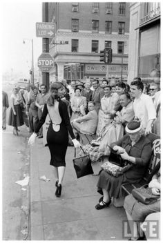 U.S. Model Vikki Dougan (Real-life inspiration for Jessica Rabbit) drawing a crowd, 1950s