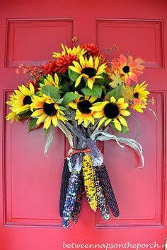 Add tons of country style to your front door by attaching Indian corn to faux fall flowers. This door decoration is festive for fall.