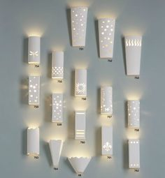 This collection of Modern & Contemporary Ceramic Light Sconces has a variety of fixtures sure to please the eye of interior designers in addition to DIY project enthusiasts.  #ceramiclamps #ceramiclightsconces #ceramicsconces #sconcelighting
