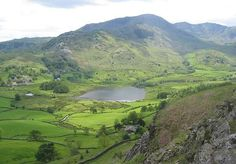 #16 Wetherlam, 763 m (2,503 ft)  -  Little Langdale Tarn at base, viewed from Lingmoor Fell.