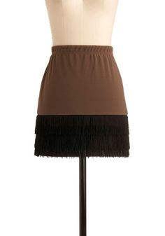 Sew some fringe on the bottom of a cheap simple cotton skirt from Ragstock.