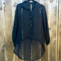 Black Button Down Top High low. Brass buttons. Sheer. Runched sleeves. Measurements upon request.  Offers are always welcomed unless specified otherwise Discounted bundles (ask for a quote) I only quote bundles No trades for this item No PayPal or any other outside transactions Tops Button Down Shirts