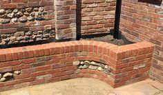 Brick retaining wall with flint panels Garden Design, House Design, Brickwork, Firewood, Cottage, Building, Wall, Home, Woodburning