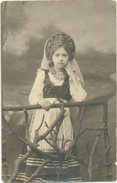 studio portrait of girl in traditional Russian costume. Imperial Russia. old photo of Russia. 19th century