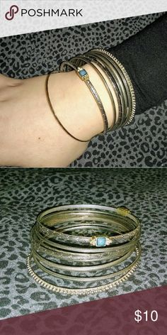 cd3b75e43fc Bangle bracelet set Silver bangles, some with designs and one with light  blue gemstones.