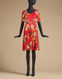 SHEATH DRESS IN PRINTED SILK WITH FLOUNCE - 3/4 length dresses - Dolce&Gabbana, and LK Bennett Fern Orange Suede Courts for her heels.