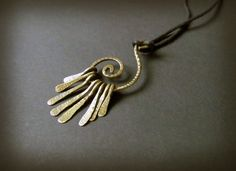 Spiral pedant Wire Wrapped Brass by Hvitolg on Etsy
