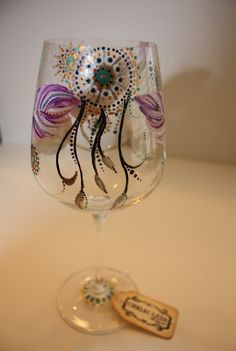 Hand Painted Wine Glass: Native American Inspired- Feathers & Dream Catcher. $40.00, via Etsy.