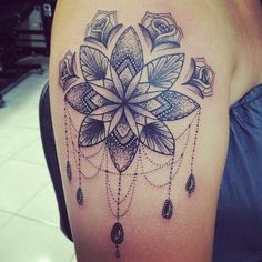 My new tattoo. Flower mandala and a bit of tweaking by my tattooist. Absolutely love it