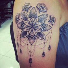My new tattoo. Flower mandala and a bit of tweaking by my tattooist. Absolutely love it