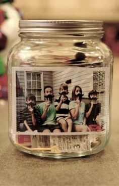 Decorate a mason jar with a family photo than leave the jar out where the entire family can see it, like on a kitchen shelf or in the family room. Throughout the year, have family members drop in random artifacts like a photograph, a movie stub, a note of their thoughts, and then on the following New Year's Eve, go through the time capsule to talk about the year you all shared together.
